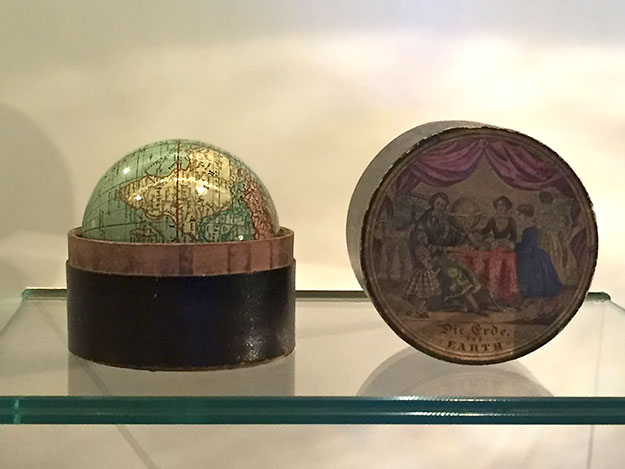 Tiny globe in its own carry-box, one of many unique globes on display at the Globe Museum