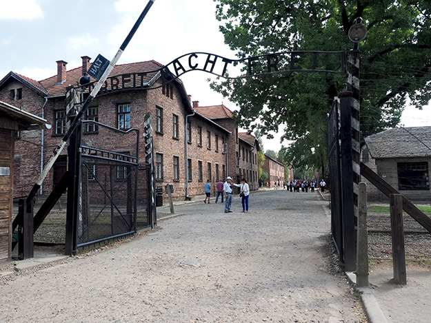 "The words ""Arbeit Macht Frei"" (Work Makes You Free) span the entrance to Auschwitz Concentration Camp"