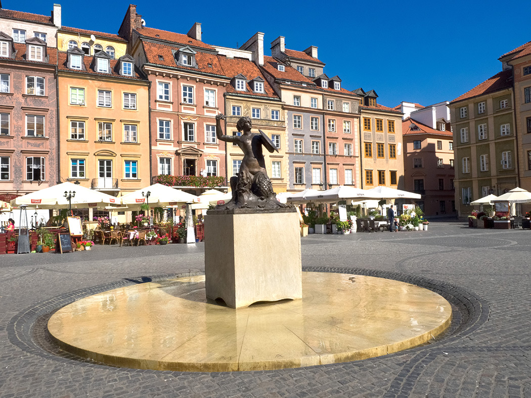 Main Square in Warsaw Old Town, With It's Iconic Dolphin Sculpture