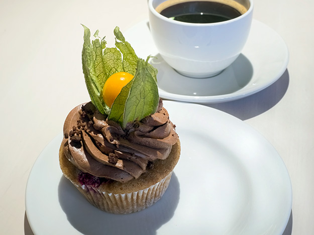 Raspberry and marzipan-filled cupcake, topped with chocolate mousse and tomatillo at Vegan Restoran V in Tallinn, Estonia