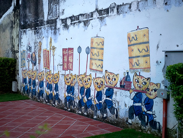 """""""Cats and Humans Living Happily Together,"""" located on Pantai Avenue"""