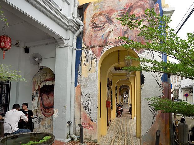 """""""Big Mouth"""" mural opens its maw over an arcaded walkway on Muntri Avenue"""