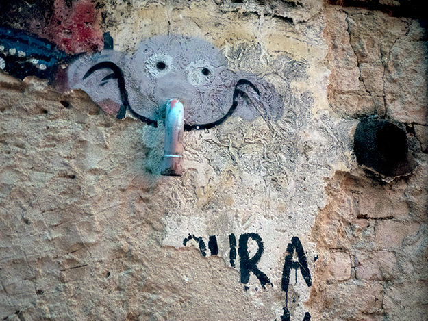 """Someone got creative with a pipe protruding from a wall on Ah Quee Street. The result was this mural, titled """"Pipe Elephant."""""""