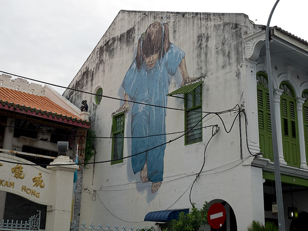 """Kungfu Girl,"" sometimes referred to as ""Little Girl in Blue,"" a mural located on Muntri Avenue"