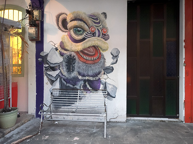 """Street art in George Town includes this fanciful piece titled """"Lion Dance,"""" on Armenian Street"""