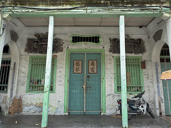 Front facade of an eclectic Chinese Shophouse in Penang, Malaysia. It exhibits the architectural style preferred by Southern Chinese who were brought to Malaysia to work in George Town and in the tin mines in Perak