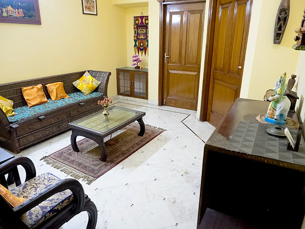 Sitting room in the expansive family suite on the third floor of Prakash Kutir B&B. The suite has three bedrooms, each with a private bath. The entire suite can be reserved as a family unit, or the bedrooms can be reserved individually, with guests sharing the common areas.