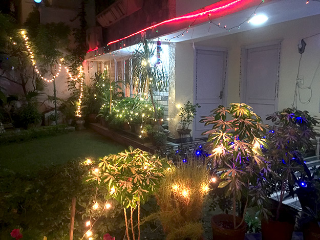 Diwali lights adorn the front of Prakash Kutir Homestay