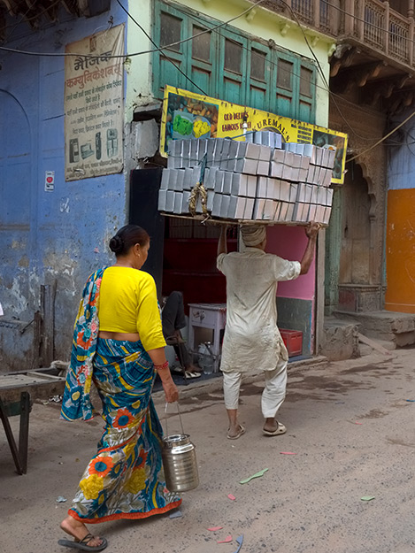 Men known as carry-wallahs tote heavy loads from one place to another in India