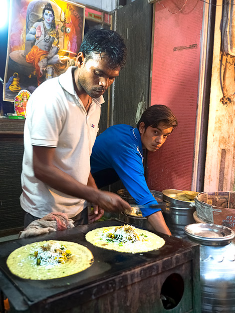 Dosa maker on the streets of the old market in Agra, India