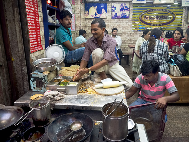 Preparing the paratha at Parathe Wali Gali in Old Delhi, a mainstay of north Indian dishes