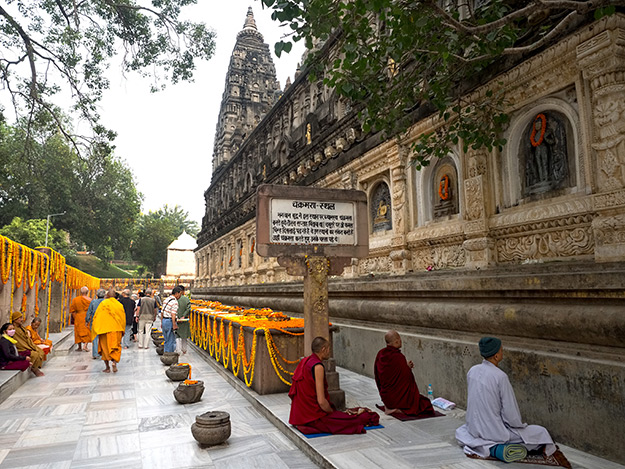 Aside the Mahabodhi stupa, stones mark Buddha's footsteps