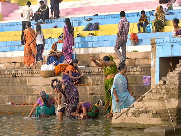 Worshipers immerse in teh Ganges River at Varanasi, India
