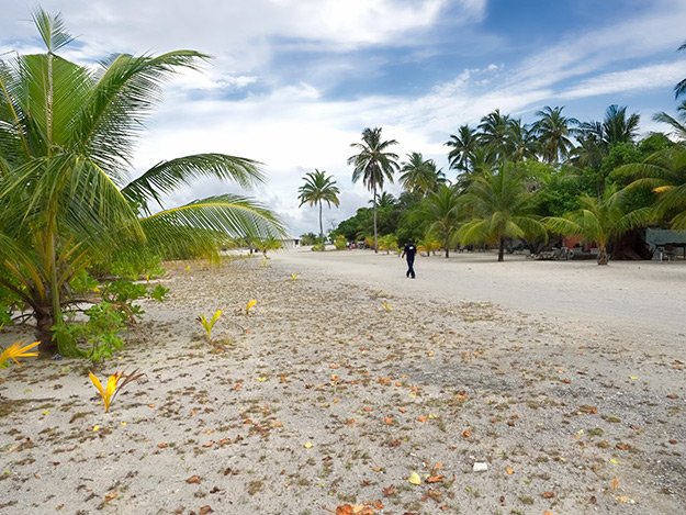 Main road leads to the harbor on Bodufolhudhoo Island in the Maldives