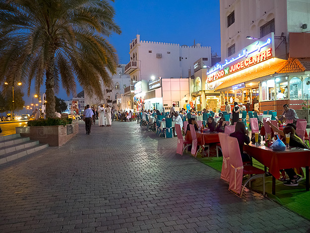 "Dining along the Corniche in the Mutrah area of Muscat, Oman. The only choices are a few expensive restaurants or these ""fast food"" sidewalk cafes."