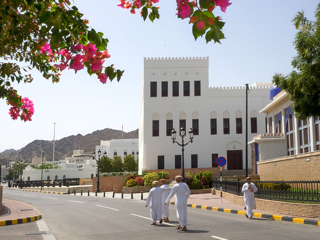 Omanis stroll down the middle of the street in Old Muscat, the original village that became the core of greater Muscat, Oman