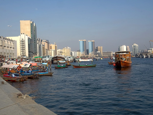 On the shores of Dubai Creek, where everything began for this shining city in the desert. The small boats in the foreground, known as Abras, ferry passengers between the shores for about 27 cents per ride
