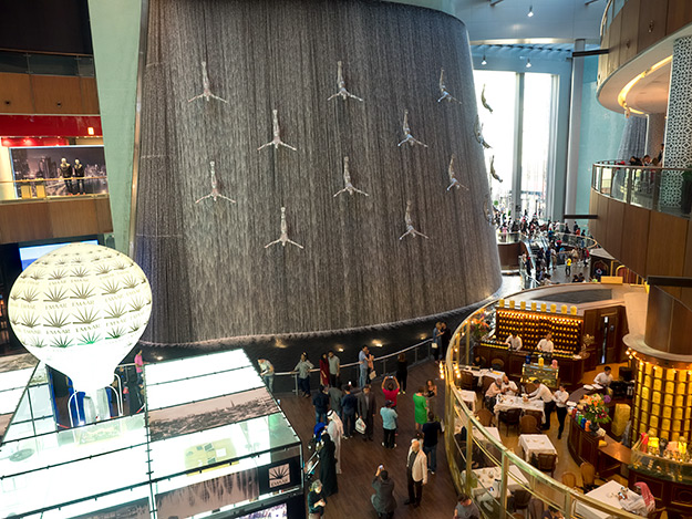 At Dubai Mall, shoppers can dine next to a huge indoor waterfall