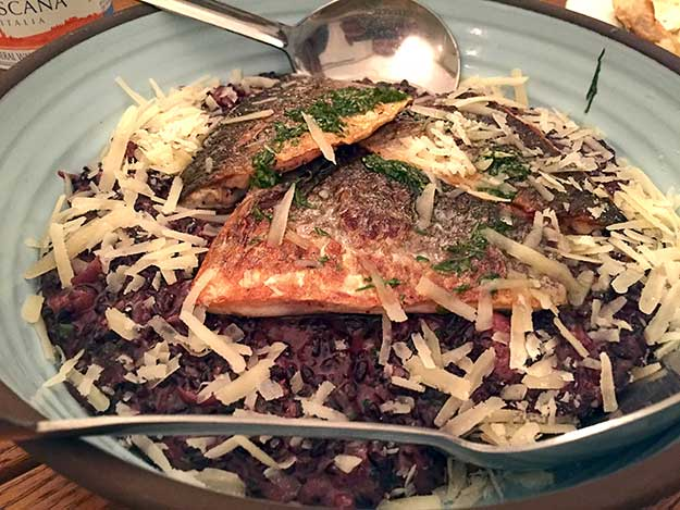 One of our main dishes at Anna Italian Cafe was black risotto with grilled Sea Bass