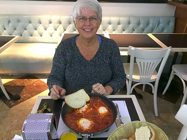 I enjoy a mainstay of Israeli food, a breakfast of Shakshuka, which is eggs poached in a slight spicy sauce of tomatoes, chili peppers, and onions