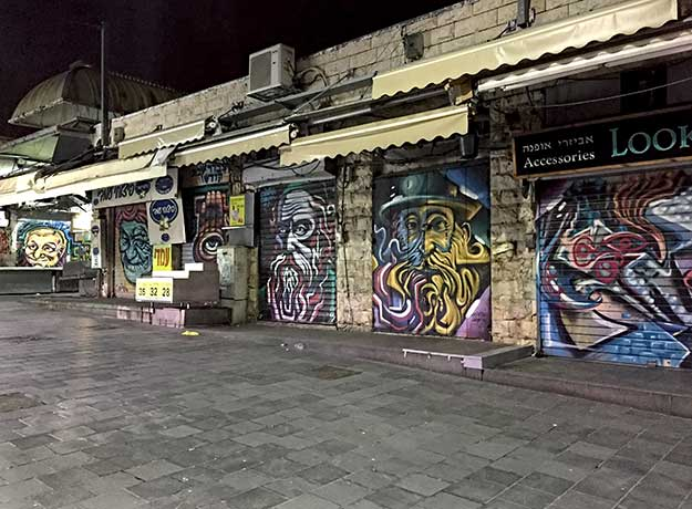 One of the best ways to view Israeli art is to visit the Machane Yehuda Market after dark, when the giant portraits of famous Jewish personages painted on the roll-down shutters are visible