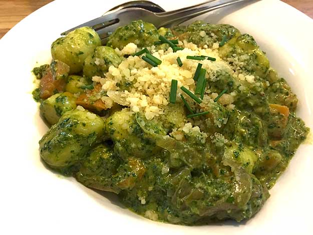 Pesto gnocchi with sweet potatoes and carmelized onions at Pasta Basta Restaurant in Machane Yehuda Market, another example of the emerging Israeli food scene in Jerusalem