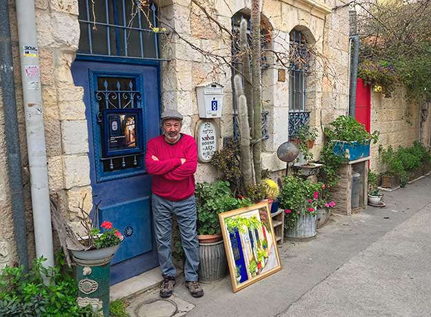 Rami Wagner in front of his 134-year old stone house in the Nachalot neighborhood of Jerusalem. He and his wife have turned the ground floor into an art gallery