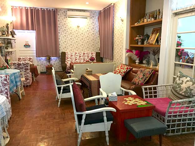 Comfortable seating inside Cozy Cafe in Chiang Mai