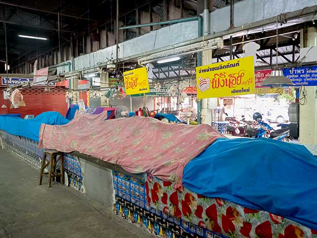 By mid-afternoon, the stands in the open-air market are shut down and covered, awaiting the next morning