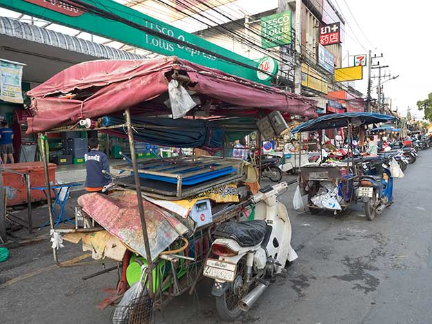 Motorcycle carts arrive around 5 p.m. to setup portable food stands at Chiang Mai Gate Market