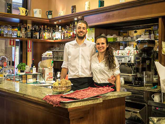 Alessandro and Barbara, proud new owners of al Bricco D'Oro bar in Bologna, Italy