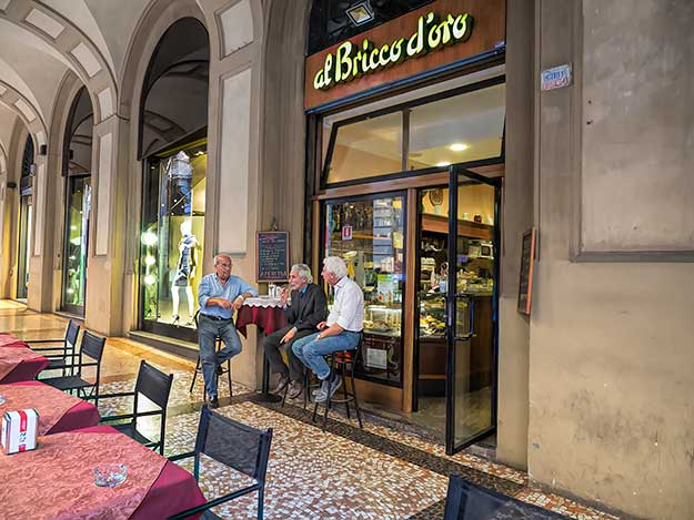 Locals sit outside of al Bricco D'Oro bar in Bologna, Italy, where they come each day for a beverage or a sweet treat