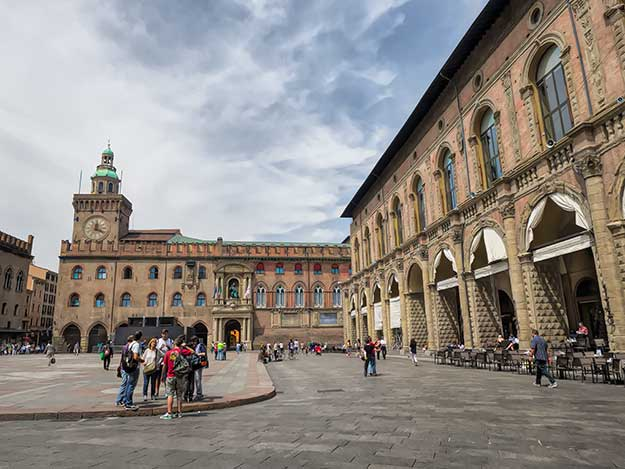 The Palazzo D'Accursio (left) on Piazza Maggiore, serves as the Town Hall and Palazzo del Podesta (right) is home to sidewalk cafes where people watching is the main activity