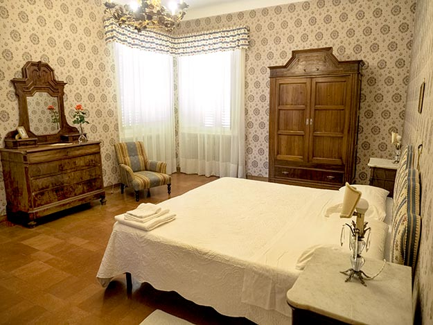 Lovingly restored bedroom in Palazzo Donati, one of eight bedrooms in the palace