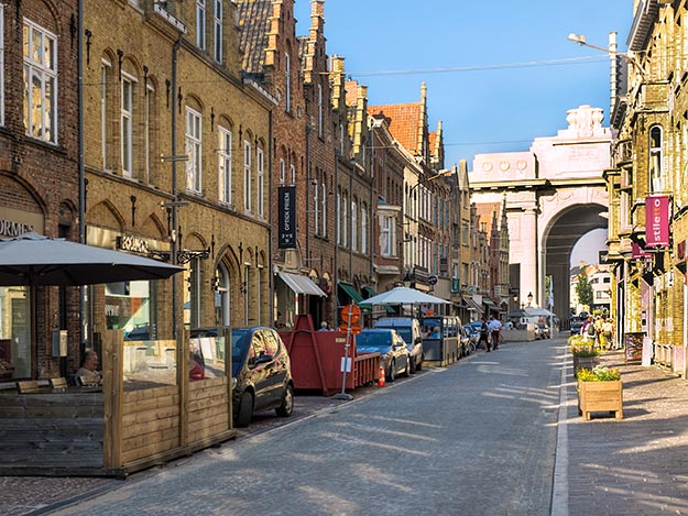 Street of Ypres, Belgium today, with the massive Menin Gate and archway at the end
