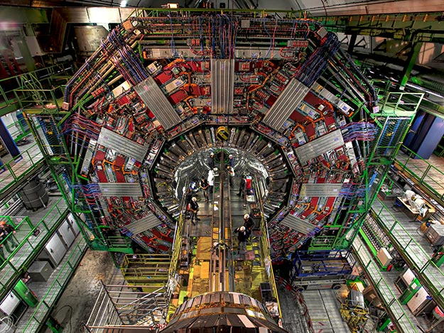 In 2009 engineers install the beam pipe in the CMS particle physics detector on the Large Hadron Collider. Photo courtesy of CERN.