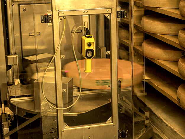 At Affineur Vagne in Poligny, France, robots are in charge of brushing, washing, and salting the giant wheels of Comte cheese