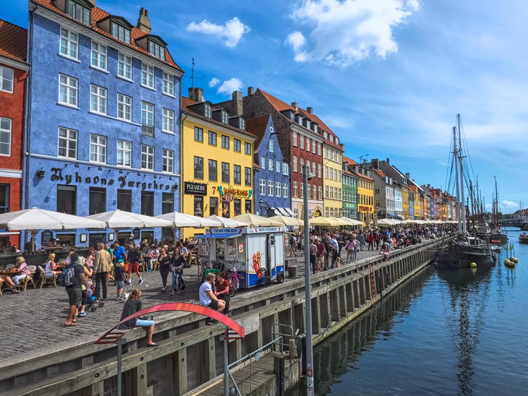 The 17th century Nyhavn Waterfront in Copenhagen, Denmark was once a busy commercial port. Today it is popular for dining and entertainment.