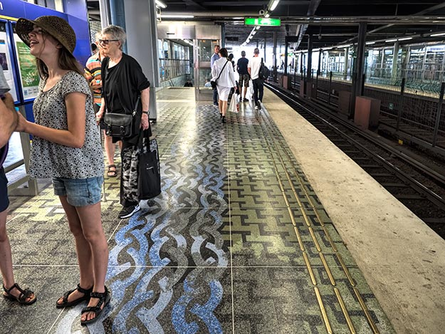 Geometric patterns on the floor of Stockholm's Gamla Stan station symbolize the Old Town's location on an island, surrounded by water