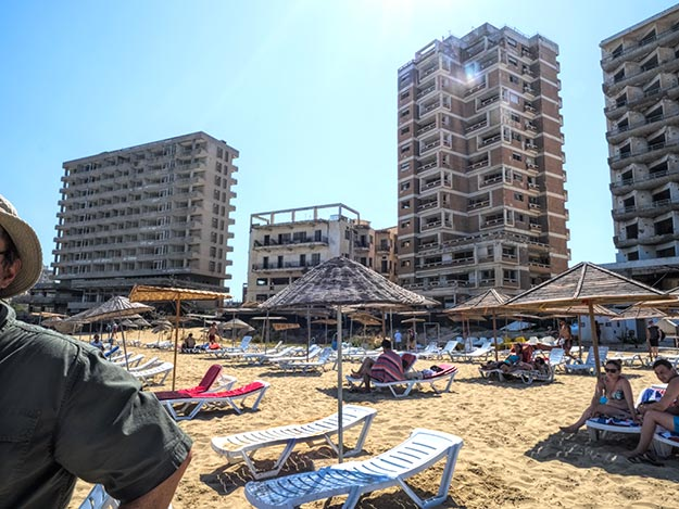 Abandoned buildings, destroyed by shelling during the 1974 war, stand behind Famagusta Beach