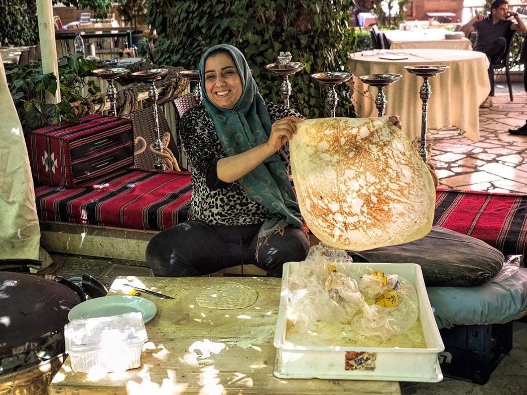 Woman at a restaurant in Lebanon's Beqaa Valley makes fresh Lebanese saj flatbread, which is rolled out by hand and baked on a domed griddle