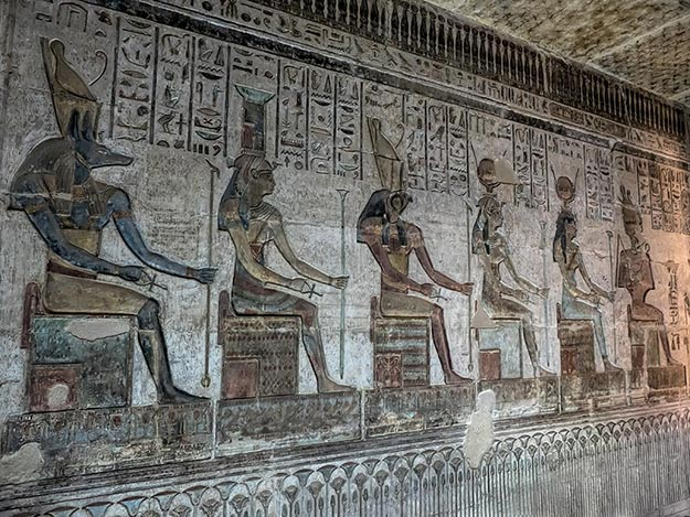 Carving of the Egyptian gods inside the Temple of the Artisans in Luxor, Egypt