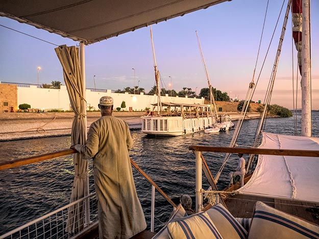 Captain of the El Nil guides us into port on the final evening of our Dahabiya cruise up the Nile