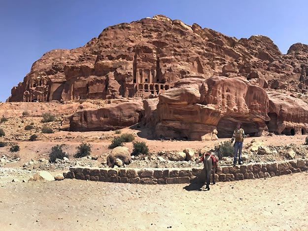 The Royal Tombs of the now extinct Nabateans loom over caves that were traditional homes to the desert-dwelling Bedouin of Petra and Wadi Rum, Jordan