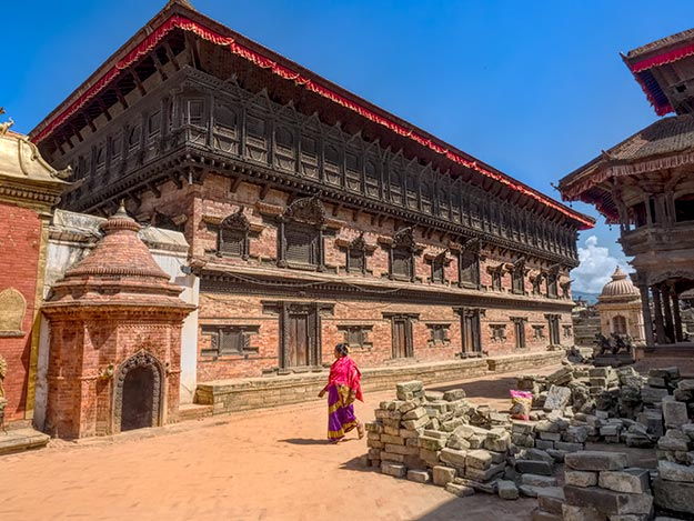 The situation is significantly different at Durbar Square in Bhaktapur. Many of the buildings, like the 55-Windows Palace, have been completely restored.