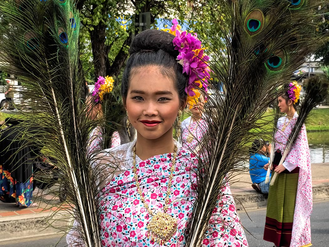 Women wear traditional dress at the 2018 Flower Festival in Chiang Mai, Thailand