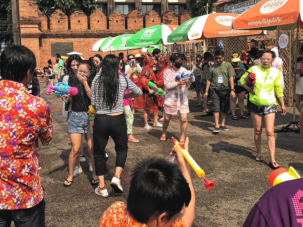 People celebrate Songkran in Chiang Mai, Thailand, by soaking one another with water guns, water canons, or even by pouring buckets of water over one another