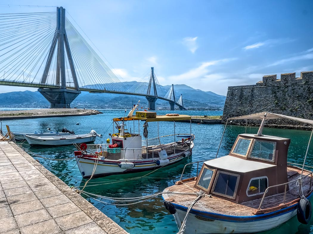 Antirrio Harbor and Fort, with the new Rio Antirrio Bridge in background, which connects the Greek mainland to the Peloponnese Peninsula