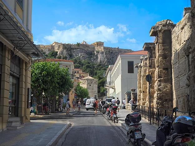 Athens simply oozes with Greek history. Here, the Tower of the Winds is directly ahead, while the Parthenon sits atop the Acropolis, watching over the city
