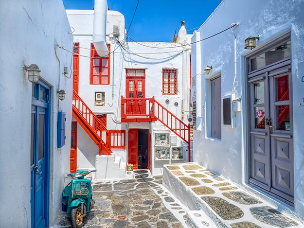 Brilliant colored trim adorns the whitewashed buildings on the island of Mykonos, Greece